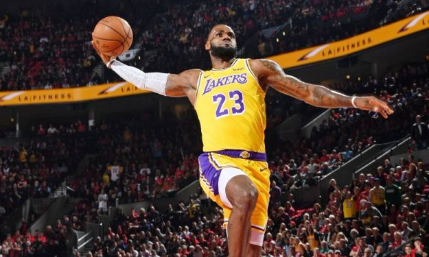 600c33c1647 LeBron James dazzles in Lakers uniform