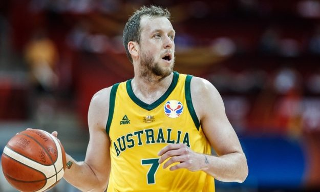 Australia into World Cup semis after Mills' 24